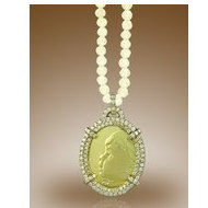 Oval Shaped Framed Pendant w  1 CT  In Diamonds